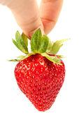Strawberry in hand — Stock Photo