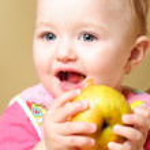 Girl eating apple — Stock Photo #5150780