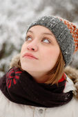 Girl's face with snow outdoors — ストック写真