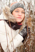 Girl's face with snow outdoors — Стоковое фото