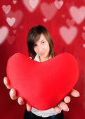 Teenage girl with red heart — Stock Photo