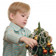 Kid dress up a Christmas tree — Stock Photo