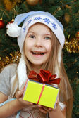Joyful Girl with Christmas present — Stock Photo