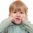 Kid grimaces — Stock Photo