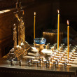 Cross and candles in the orthodox church — Stockfoto