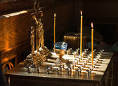 Cross and candles in the orthodox church — Foto Stock
