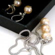 Women's jewelry white pearl - Stock Photo