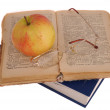 Apple and glasses on book — Stock Photo #4345291