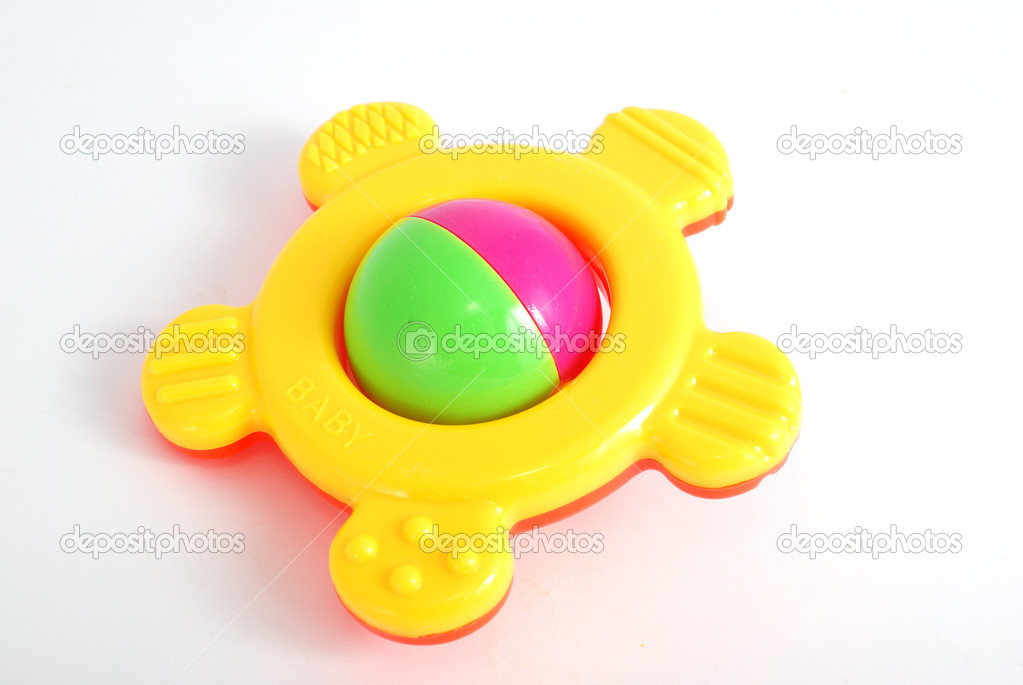 Children&#039;s rattle from plastic on a white background  Stok fotoraf #4344217