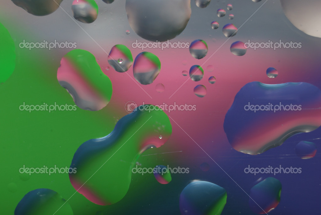 Multi coloured drops from water on glass — Stock Photo #4344542