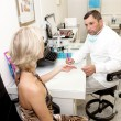 Doctor,examining a patient — Stock Photo