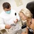 Stock Photo: Doctor,examining a patient