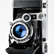Old vintage photo camera - Stock Photo