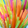 Multicolor flexible straws in the glass closeup — Stock Photo
