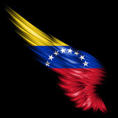 Abstract wing with Venezuela flag on black background — Stock Photo