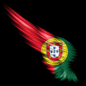 Abstract wing with Portugal flag on black background — Stock Photo