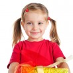 Cute girl wih the gift — Stock Photo #4026426