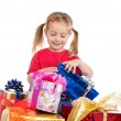 Stock Photo: Cute girl wih gifts