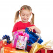Cute girl wih the gifts - Stock Photo