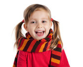 Cute little girl in a striped scarf — Stock Photo