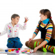 Boy and his mom covered in bright paint — Stock Photo #4129113