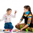 Boy and his mom covered in bright paint — Stock Photo