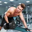 Royalty-Free Stock Photo: Muscular man working his biceps