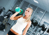 Women lifting free weights with a smile — Stock Photo