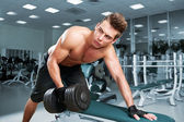 Muscular man working his biceps — Stock Photo