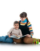 Women read the book to her son — Stock Photo