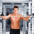 Muscular man working  with the rod — Foto Stock