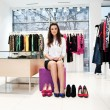 Young woman trying on shoes — Stock Photo #4314759