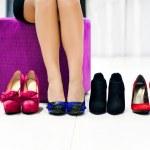 Woman chooses shoes — Stock Photo