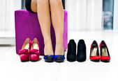 Woman chooses shoes — Stok fotoğraf
