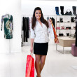 Young women with packages in the shop — Foto Stock