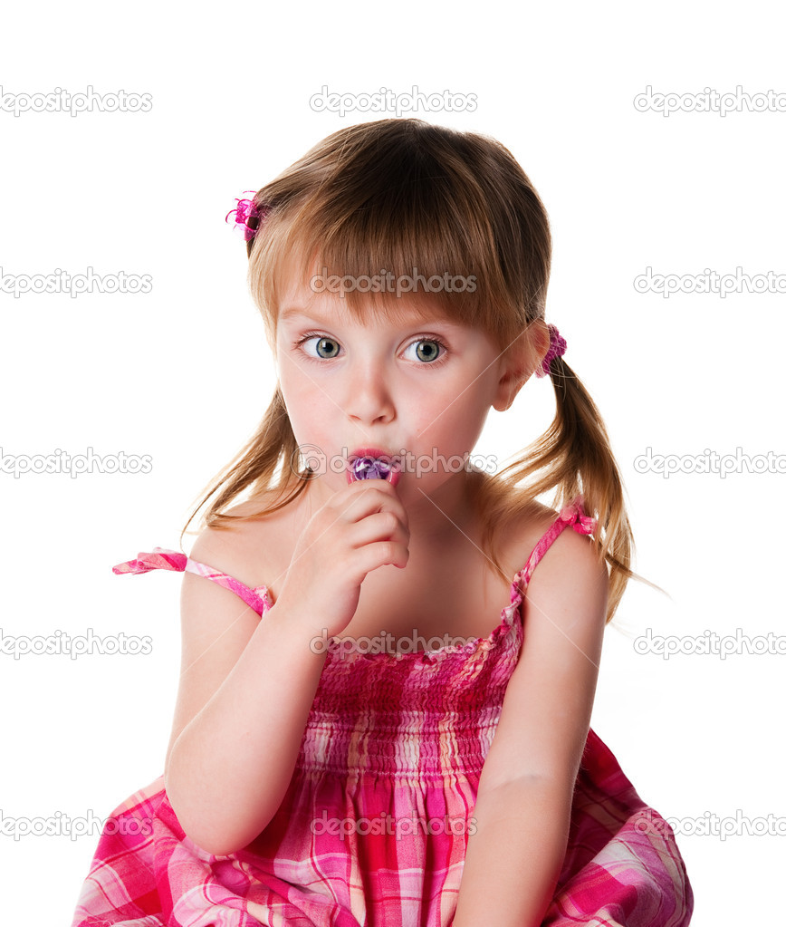pretty little girl with lilac lollipop stock photo. Black Bedroom Furniture Sets. Home Design Ideas