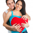 Young couple with a heart — Stock Photo #4756326