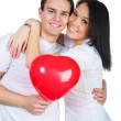 Young couple with a heart — Stock Photo #4756409