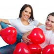 Young couple with a hearts — Stock Photo