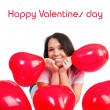 Cute young girl with a red hearts — Stock Photo