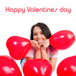 Cute young girl with a red hearts — Stock Photo #4756531