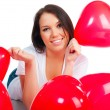 Cute young girl with a red hearts - Stock Photo
