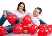 Ungt par med en hjärtan — Stockfoto