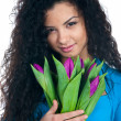 Cute young women with the flowers — Stock Photo