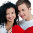 Young couple with a heart — Stock Photo