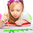 Adorable little girl drawing artwork — Stock Photo