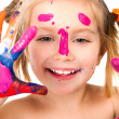 Little girl with paint — Stock Photo #5322202