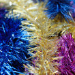 Multicolored tinsel background — Stock Photo