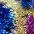 Multicolored tinsel background — Stock Photo #4296975