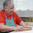 Elderly womkneading dough — Stock Photo #4661189
